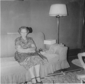Grandmother seated on couch