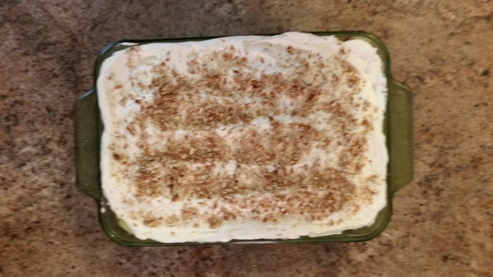 Top with whipped topping and chopped nuts