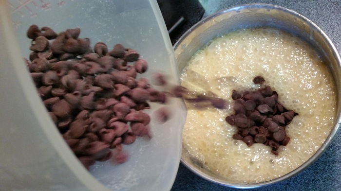 Pouring chocolate chips into hot sugar mixture