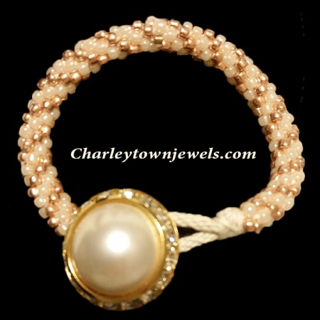 Button closure white and gold bracelet
