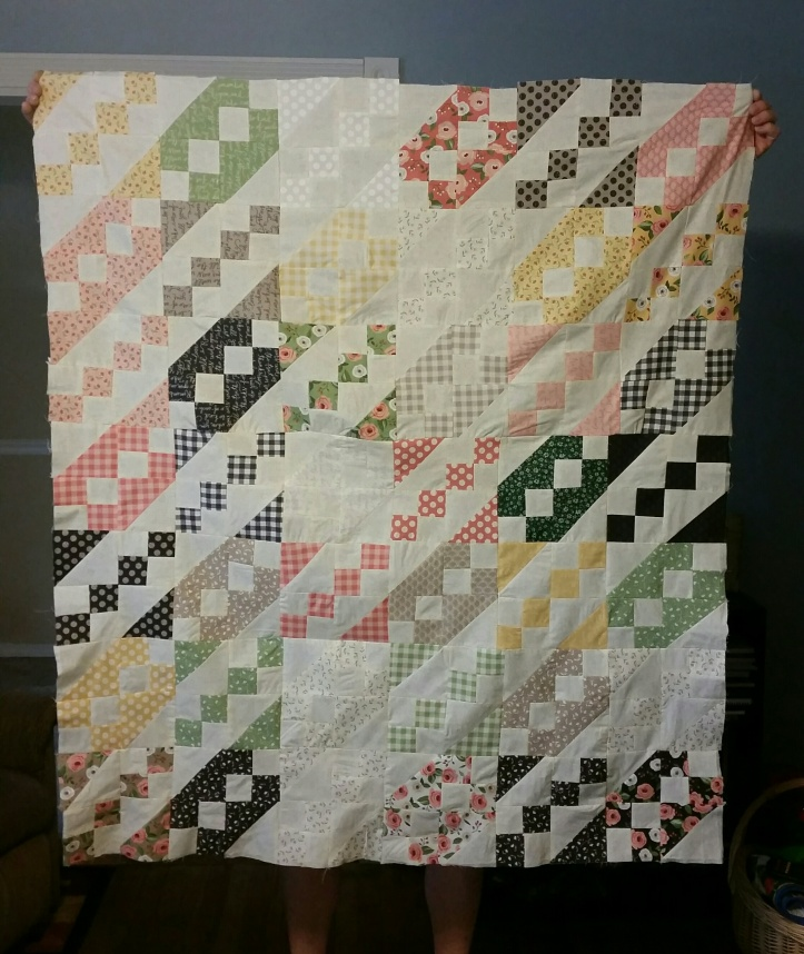 holding quilt up