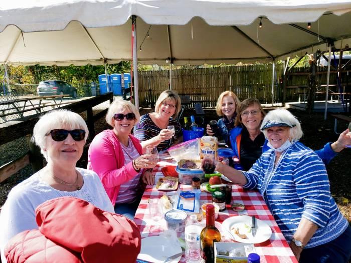 Women sitting around a picnic bench
